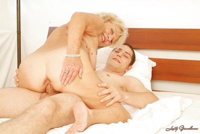 Lustful adult with massive jugs gets her hairy cunt satisfied by a younger boy