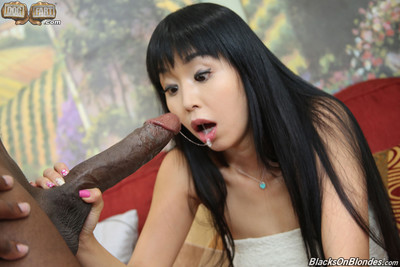 Oriental gal acquires fucked by massive black cock
