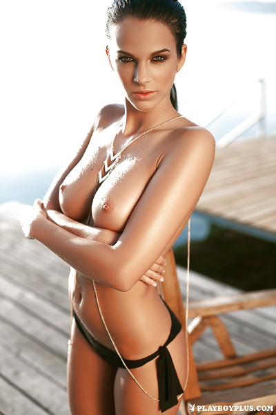 Skinny beach babe Sophie posing for centerfold release in ebon bikini