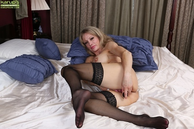 Older lady Christina Brim toying her aged pussy with ribbed vibrator