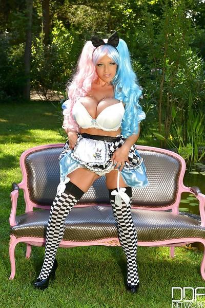 Cosplay attired solo model Delzangel revealing heavy milk cans outdoors