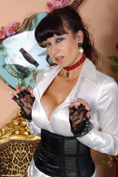 busty clothed sex fetish model Trinity as a kinky rockabella in stockings, suspender panty and very tight satin blouse. Her frilly suspender panty is crotchless and her hunky clits are sticking out