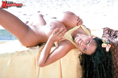 Beach babe Busty Angelique flaunting massive Latina pornstar whoppers outdoors