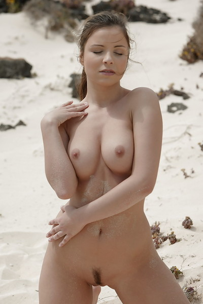 Big titted pornstar babe posing professionally on the beach