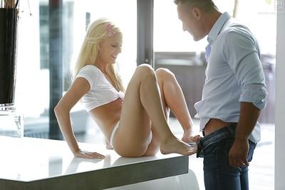 Barefoot golden-haired pornstar Candee Licious jerking dick for spunk flow on leg