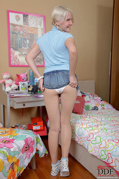 Euro teen with pigtails is stretching her ass to the maximum