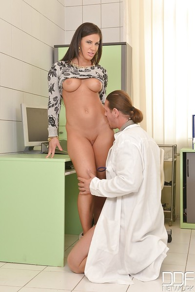 Busty Euro model Athina sucks the doctor