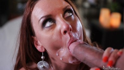 Redheaded Janet Mason has her mature pussy worshiped and licked