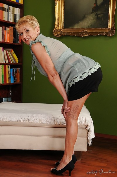 Smiley short-haired granny with ample ass acquires rid of her clothing