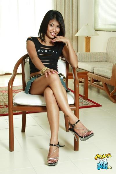 Moist thai girl som fingers she is in a chair