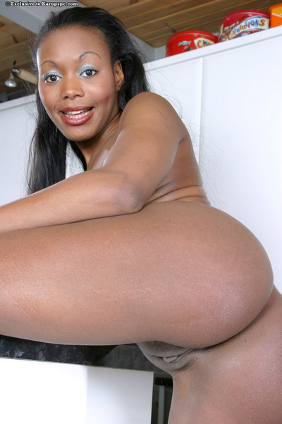 Ebony youthful Karis takes part in an infant posing scene in close up