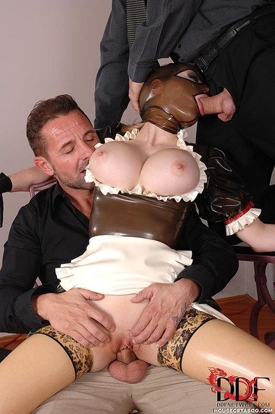 Kinky BDSM fetish model Latex Lucy deepthroating cock in extreme MMF threesome