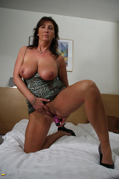 This sexually excited cougar gets sodden on her couch