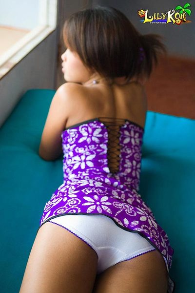 Lily Koh flashes white cotton panties under a purple dress