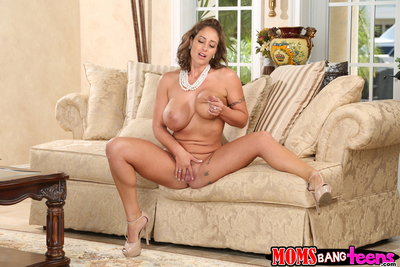Tattooed brunette Eva Notty is playing with her excellent mammoth boobs