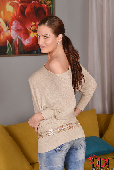 Tall brunette seducteress in jeans undressing and spreading her legs