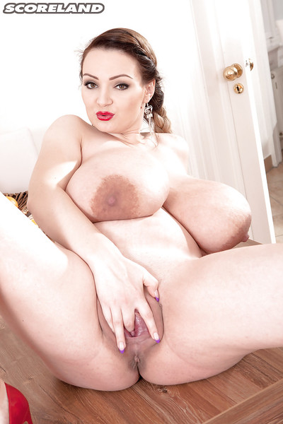 Plumper Micky Bells unleashing heavy knockers ahead of jacking off