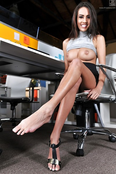 Curvaceous brunette Janice Griffith adores her own long legs and cave