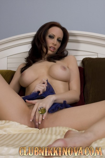 Busty brunette, Nikki Nova, lounges in bed and puts on a untamed stripping out of her pink and royal blue underclothes showing her major tits and pussy to the camera!