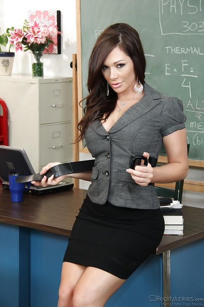 Stunning patriarch in dress clothes revealing her goods in the classroom