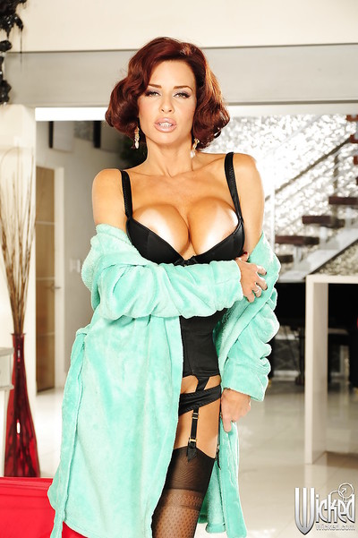 Gorgeous milf pornstar in clammy lingerie shows off her gigantic tits.
