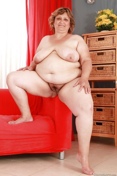 Fatty elderly with huge tits and ass stripping and spreading her legs