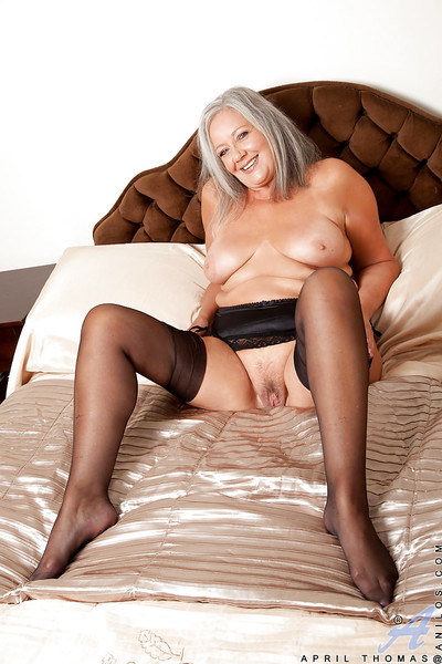 Fatty granny in nylons taking off her lingerie and toying her twat