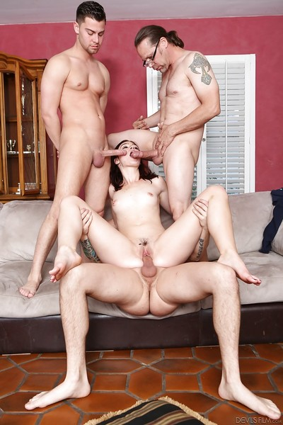 Amazing brunette Jodi Taylor is getting group-bonked by 3 cocks