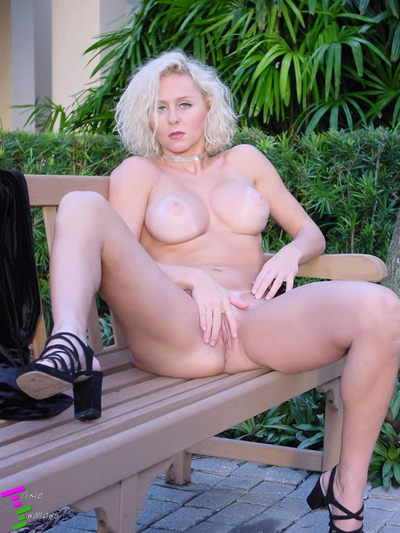 Beautiful blonde strips out of her black outfit while outside