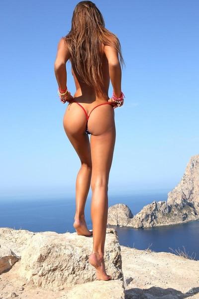 Skinny bikini instance strips in the sun