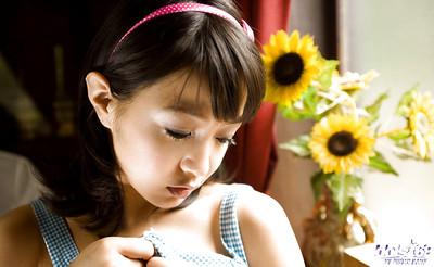 Stunning asian teen doll Nana Nanami slipping off her garments