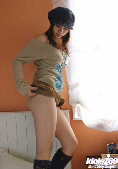 Seductive asian coed with petite mambos and hairy bawdy cleft slipping off her clothing