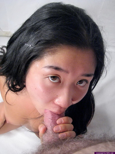 Teen asian giving head to stallion who cums in her face hole