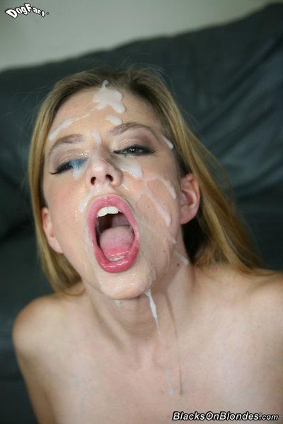 Slender blonde opens up each hole for large black phallus insertion