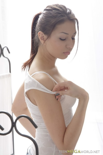Gorgeous brunette enjoys a hot sex massage at teen mega world