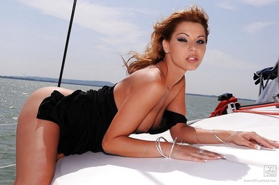 Busty pornstar Cindy Hope gets undressed off her suit and location on a boat