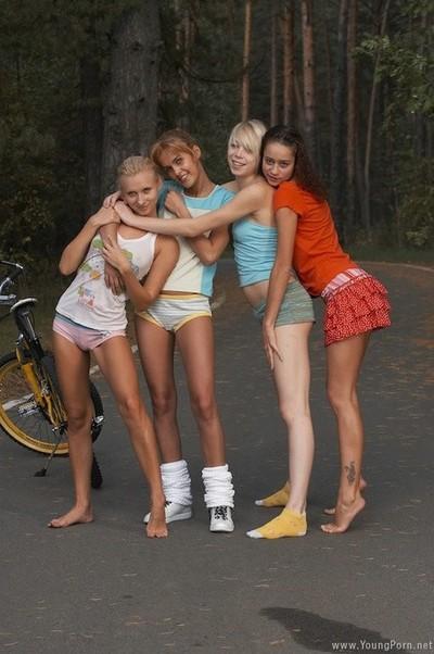 Teen lesbian girlfriends in outdoor public gangbang