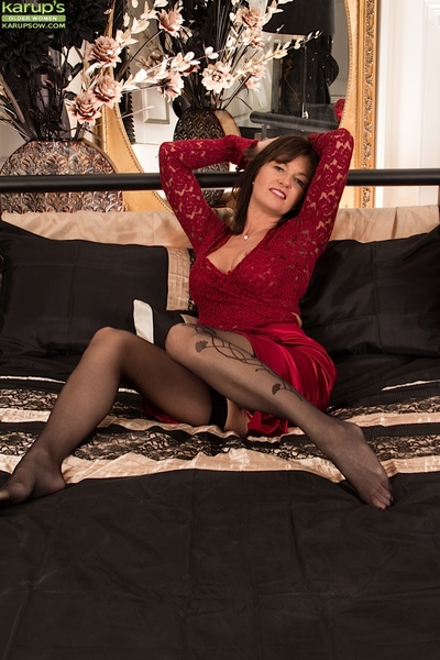 Placid dark brown in red lingerie showing her big bazookas and nipples