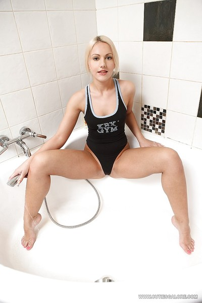 Marvelous babe Vania shows off her oiled young butt in the shower