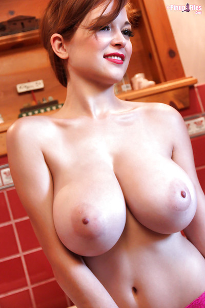 Gorgeous red-head lass Tessa Fowler unveils her fantastically large tits