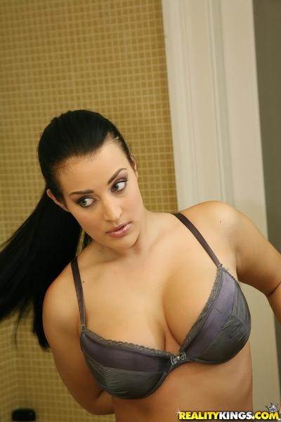 Titsy brunette Carmen Croft caressing her huge love bubbles in the shower
