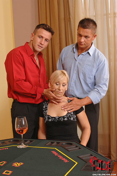 Golden-haired MILF Slobbers On Three Dicks