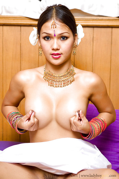 Big tit Thai ladyboy Amy showing off her miniature penis and pretty face