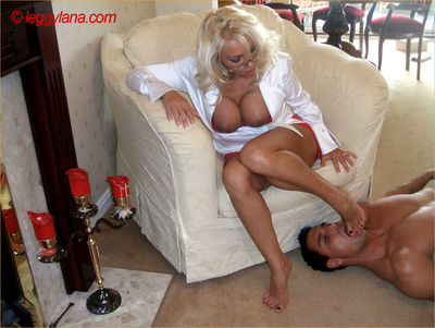 Lana is dressed in a tight white dress and gets her feet licked by a stud