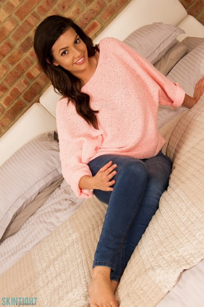 Beauty brunette in her rigid jeans sweater and sexy undies