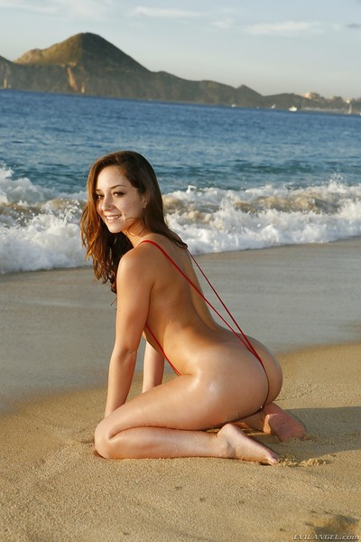 Beautiful babe Francesca Le shows those titties and ass on the beach