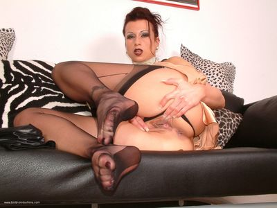 Kinky legsex with a busty glamour lady in appealing clothing and stockings. She is sucking a guys 10-Pounder then rubbing it with her feet pending he shoots all his warm load onto the soles of her feet.