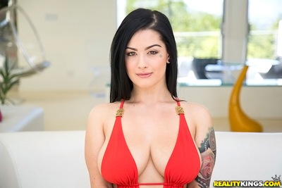 Bikini model with big tits Katrina Jade is showing her hot tattoos