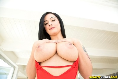 Bikini model with big tits Katrina Jade is showing her hot tattoos