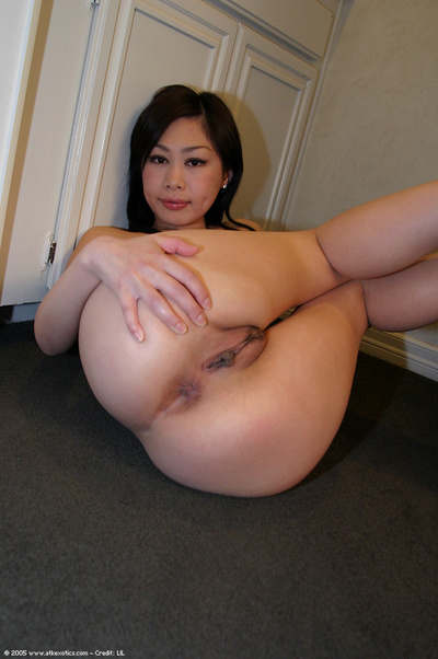 Asian first timer sliding panties over gazoo in kitchen for twat stretching